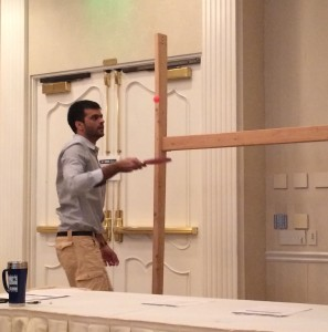 Sainyam Cautam, a contestant in the HiQora High IQ World Championships, tried to keep knocking a ping pon ball over a wooden bar without it falling to the ground.