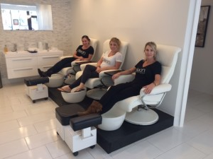 Clean Beauty Bar recently had a soft opening near Park Avenue. Seated here are owner Kelly Newton (front), front desk manager Chelsea Bissonnette (center) and Jaime Morente, the vice president of spa services.