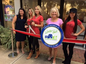 The staff at Clean Beauty Bar, including founder and CEO Kelly Newton (third from the left), join with Winter Park's vice mayor, Sarah Sprinkel (fourth) for the grand opening celebration of Clean Beauty Bar, Park Avenue's only all-natural and organic day spa.