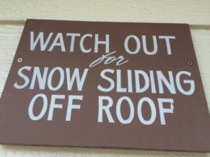 snow on roofs sign